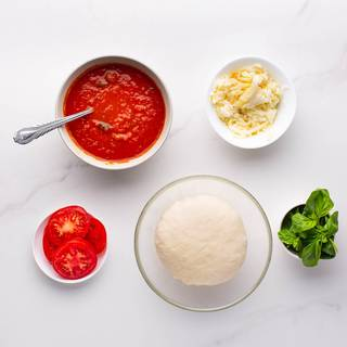 You can see the pizza dough and tomato sauce recipe in the link to the ingredients section