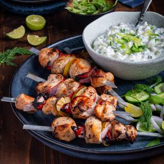 Cook in the grill at medium heat. Grill each side for 5 to 7 minutes. Take the chicken off the grill and drop some fresh lemon juice on it. Serve it with the tzatziki sauce.