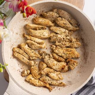 Saute chicken breasts with olive oil in a pan.