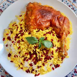 Gently spoon about 1 cup cooked rice from pot and arrange on a platter. Scatter 2 tablespoon berries and a quarter of Saffron Chicken on top OR Serve it Persian style, so that spoon in rice to big platter and design it with barberries mixture, on a separate plate serve chicken with its sauce.