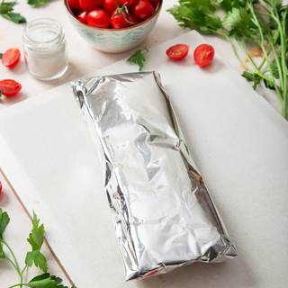 Wrap it with some foil, this way so you can put it in the oven or keep it in the freezer.
