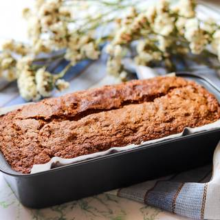 put the loaf pan into a preheated oven at 170°C (340°F) for 50 minutes. For testing, dip a wooden stick into the cake and if it comes out clean, that means that the bread is ready and if it didn't, put it back into the oven again.
