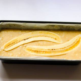 Fill the pan with the mixture and cut half of a banana from the middle and put it on the cake's mixture, if you like.