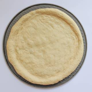 After flattening, cover the dough and let it rest for a quarter.