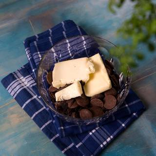 In a bowl, melt butter and chocolate on indirect heat( Bain Marie). If using a microwave, stir the chocolate every 30 seconds in order not to burn.