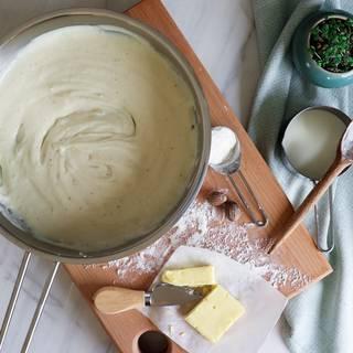 Béchamel sauce in steel dish