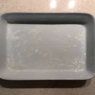 Grease and flour a baking pan.