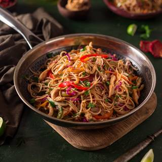 Take the chicken chow mein off the heat and serve it immediately.
