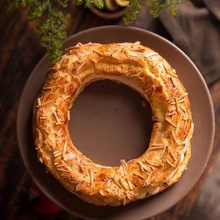 Cut the Paris Brest in half and pipe the caramel whipped cream filling inside it with your favorite tip.