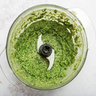 Turn on the food processor and mix all the ingredients well until they are combined. Your sauce should have a soft texture and be light green.