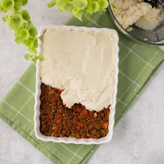 Fill a proper dish with the beef and cover it with the cauliflower topping completely.