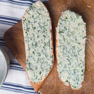 Cover the bread with butter, garlic, and parsley mixture.