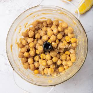 Add the chickpeas to the blender and mix until the mixture is well blended.