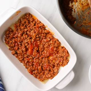 meat sauce in the lasagna dish