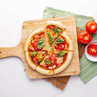 Finally, pour the fresh basil over the pizza and enjoy.