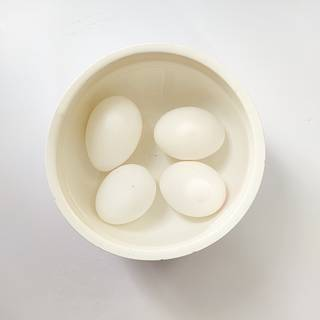 Remove eggs from hot water then put them in cold water. After one minute you can remove the eggshells easily.