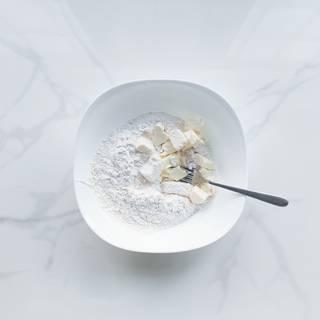 Mix flour, cold butter, sugar, and salt with a fork.