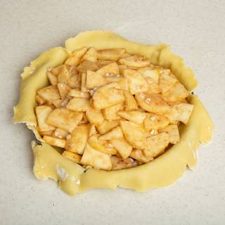 Pour the apple and cinnamon mixture inside your pie.