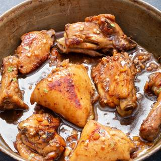 Heat the frying pan and put the chicken pieces in the frying pan until golden and completely cooked. If you are using chicken with bones, after frying both sides of the chicken, low the flame and put the frying pan lid, let the chicken cook more while flipping the chicken over every five minutes.