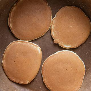 When bubbles come up on the pancake's surface, it means they are ready, and you can serve them. When you heat your pancake without any oil, you reach a smooth and delightful appearance which is highly tempting. You can see it in this picture.