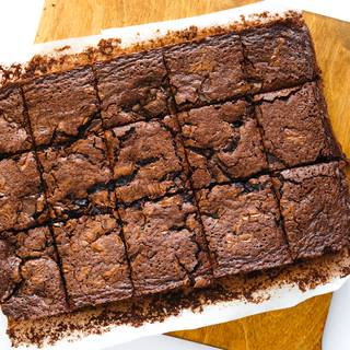 Let your brownie cool a bit then remove the paper and cut it.