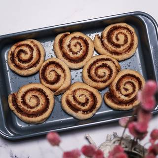 The roles will become double in size. Put them in the warmed oven at 180C for 25 to 30 minutes until they are completely cooked.