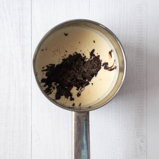 Break the chocolate bar and add to the mixture. Remove the saucepan from the heat and add chocolate immediately to the cream and stir it until it melts.