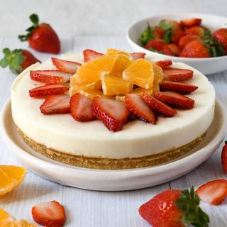 It's finally time to take your pan out of the fridge! This is the exciting part where you get to have fun decorating your cake using various fruits or colorful jello and take it to the next level. Hope you enjoy your no-bake cheesecake. Bon appetite!