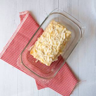 Finally, top with Béchamel sauce and cheese. Bake for 20 minutes until cheese is golden.