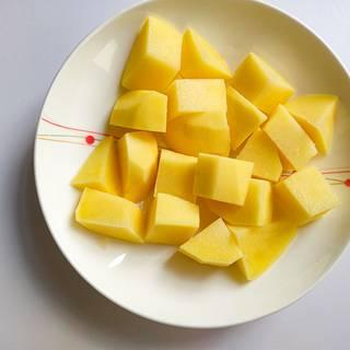 Peel the potato and chop.