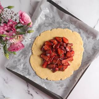 Put strawberries in the middle of the dough. But from each side, there should be 3-centimeter space.
