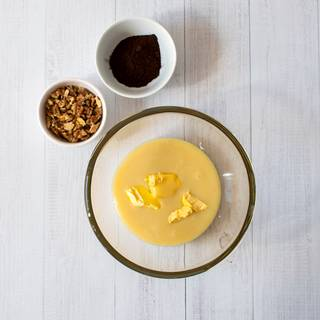Mix room temperature butter with condensed milk and stir.