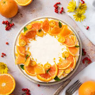 After that, remove it from the springform pan and garnish it with orange pieces or any fruits you like.