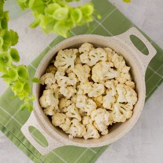 Fill half of a pot with water and cook the cauliflowers for 10 to 15 minutes on the heat until the water comes to boil and the cauliflowers become soft.
