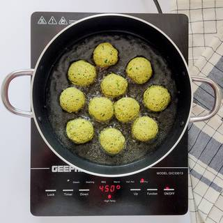 pour enough oil in a pan and wait until it's hot, then fry the falafels in the pan.