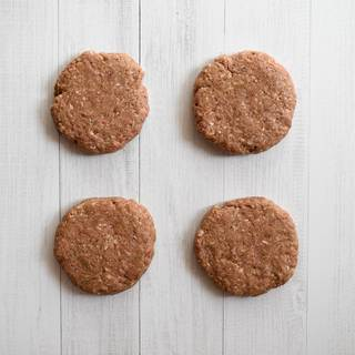 Divide the beef into 4 even parts, and shape it into patties with your hands. Heat the oil in a nonstick pan and fry the burgers. You can also grill them on a barbecue grill.