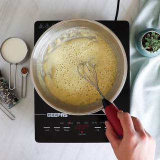 Flour and butter are melting on stove
