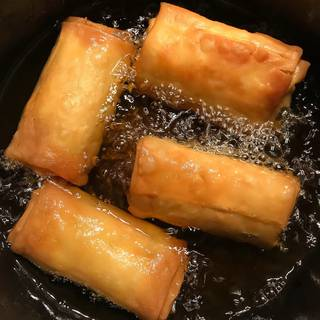 Fry the egg rolls about 3 to 4 minutes and turn occasionally until they are golden brown on all sides.