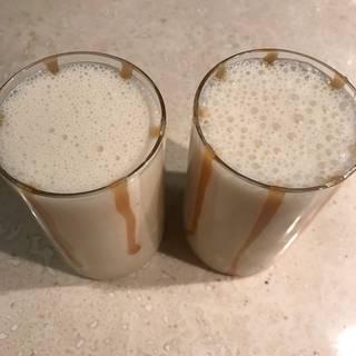 Pour the milkshake into the glasses.