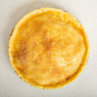 Use a sharp knife to make some cuts on your pie. Put your pie in the oven and bake it at 180°C (360°F) for about one hour.