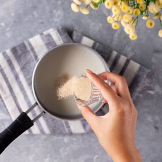 Mix the milk with sugar and put it on the heat to become warm (about 40C). Take it away from the heat, add the instant yeast and cover it. Let it rest for about 10 minutes so the yeast is activated.