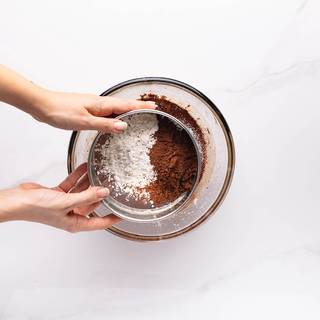 Sift flour and cocoa powder and add them to your batter. add salt and vanilla in the end and whisk until everything is combined well.