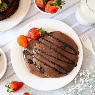 Your chocolate pancake is ready. You can enjoy it with chocolate sauce, cream, hazelnut chocolate, or other different types of fruits.