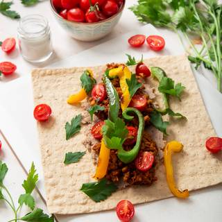 Add fried sweet pepper to your fillings. You can use them in different colors. Add some fresh parsley to make your burrito smell better.