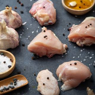 First, prepare your chicken pieces and cut them into medium pieces.