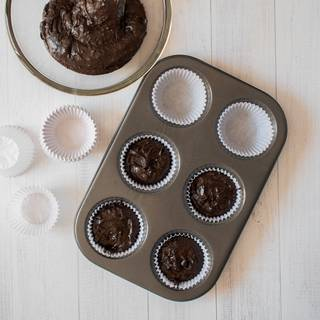 Put cupcake papers into your tin. Pour the batter inside them and put the tin inside the oven. Remember, don't overfill them with batter. The cupcakes would rise when you bake them.