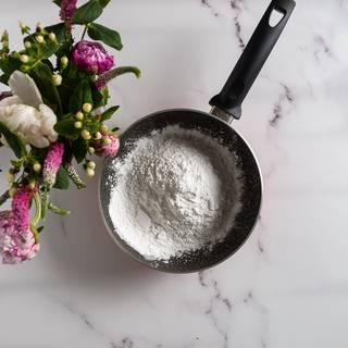 Mix sugar, Cornstarch, and salt in a thick pot then add the milk slowly and mix them well.