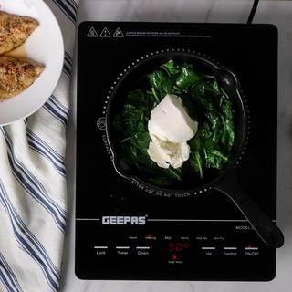 Adding cream cheese to spinach