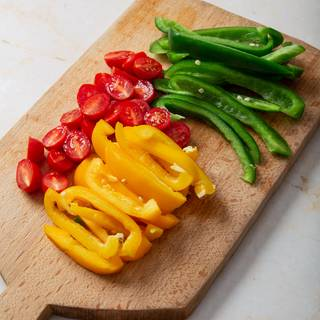 Chop your vegetables and fry them for 5 minutes to make them ready to use in your filling.
