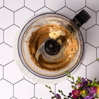 Add butter, fresh lemon juice, and cinnamon to your food processor and blend everything together for 30 minutes.